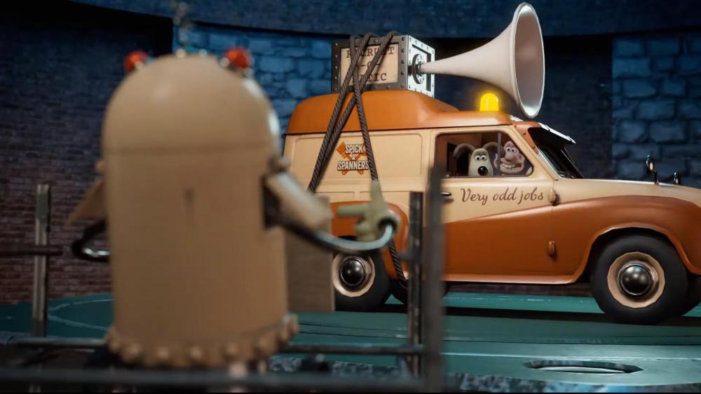 Die Claymation-Figuren Wallace & Gromit sitzen in ihrem Auto und winken einem Roboter zu