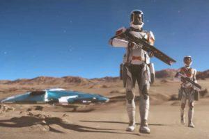 Zwei bewaffnete Astronauten gehen auf einem sandigen Planeten. Im Hintergrund sieht man ein kleines Raumschiff (Elite Dangerous: Odyssey)