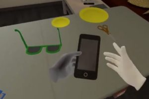 Virtuelle Hände greifen ein virtuelles Smartphone mit korrekten Hand-Posen mittels Quest-Handtracking