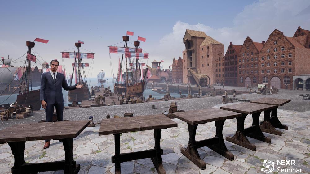 NeXR VR-Seminar Bild aus der Virtual Reality, stilisierte Seminartische vor Hamburger Hafen als Kulisse für ein VR-Seminar