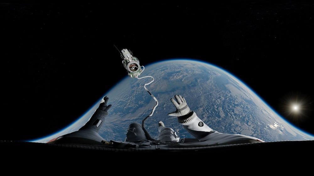 Blick eines Astronauten über das Seil, das ihn beim Spacewalk sichert, auf die Erde.