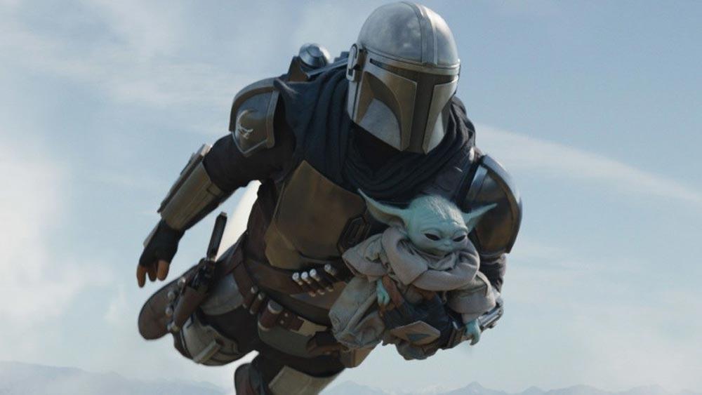 Der Mandalorianer fliegt mit Baby Yoda / Grogu im Arm