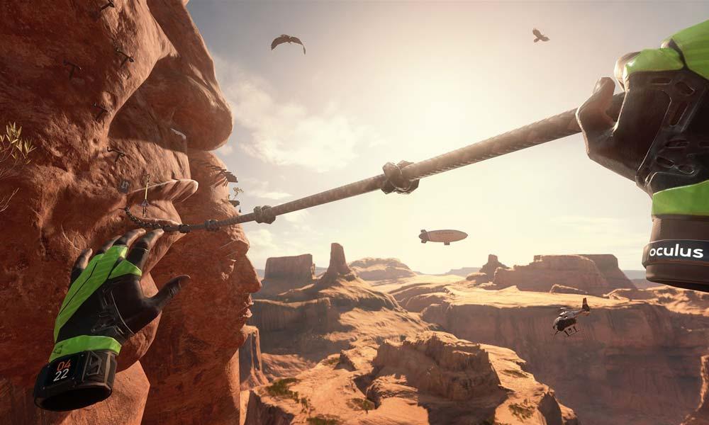 Szene aus einem Computerspiel, zwei Hände ziehen sich über einen Canyon