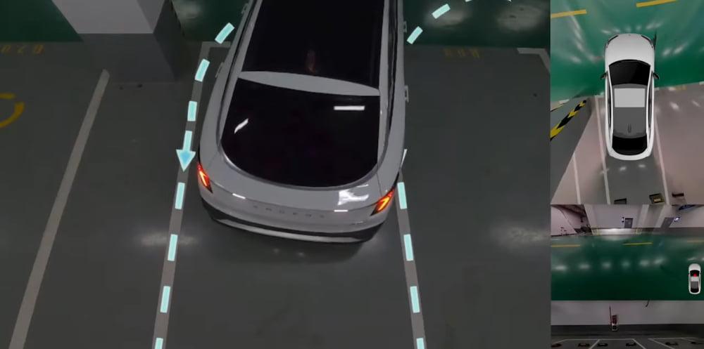 Ein autonom fahrendes Auto der Marke ARCFOX parkt automatisch in einem Parkhaus ein.