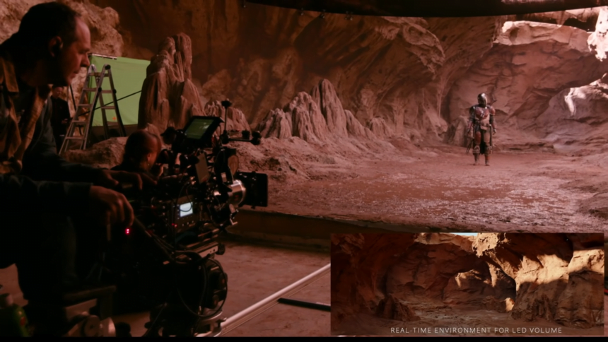 Ein Kameramann filmt eine virtuelle Bühne.