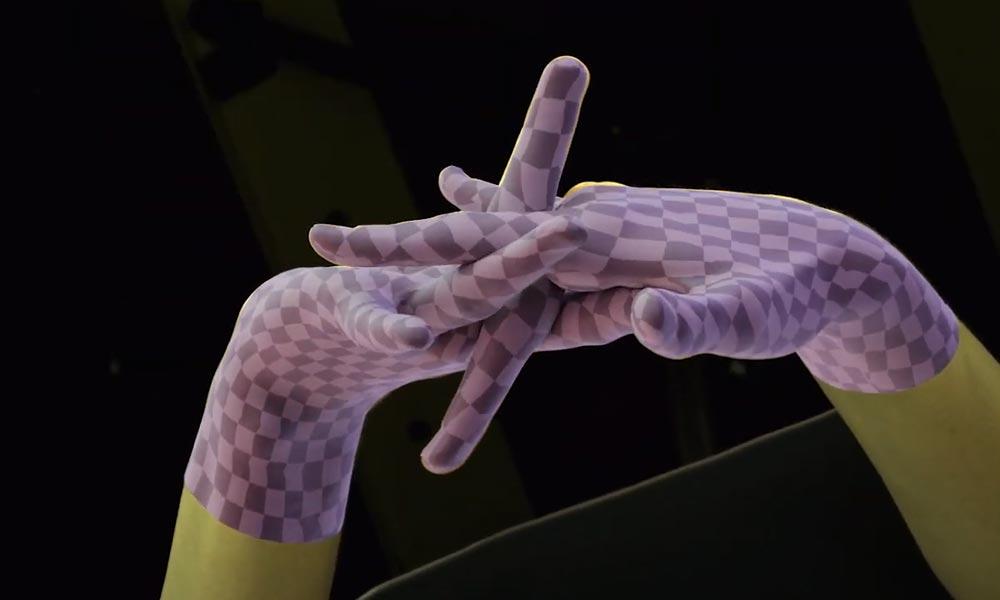 Zwei Hände greifen ineinander, dennoch erkennt Facebooks Handtracking die Finger.